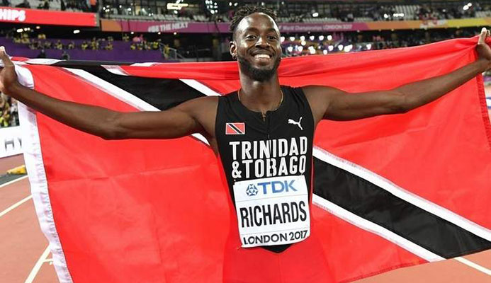 Trinidad and Tobago's Jereem Richards celebrates after winning third place in the final of the men's 200m event at the 2017 IAAF World Championships at the London Stadium in London on August 10, 2017. / AFP PHOTO / Andrej ISAKOVIC