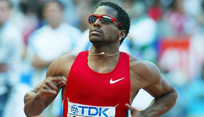 Ato Boldon of Trinidad and Tobago competes in heat ten of the men's 100m August 24, 2003 during the 9th IAAF World Athletics Championships at the Stade de France in Saint Denis, outside Paris. CREDIT: Getty Images