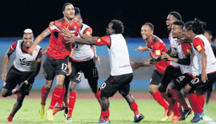 Trinidad and Tobago's Alvin Jones (17) celebrates with teammates after scoring against United States in their final round Concacaf Zone World Cup qualifier at the Ato Boldon Stadium, Couva, last night. T&T won 2-1 to end the USA's hopes of reaching Russia. PICTURE AP