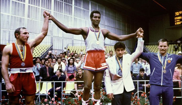 Teófilo Stevenson won the Olympic heavyweight boxing title in 1972, 1976 and 1980. Here, he celebrates victory over Pyotr Zaev of the Soviet Union in Moscow at the 1980 Games. Photograph: Staff/AFP