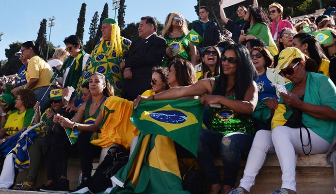 People holding Brazilian flags, attend the Handover Ceremony of the Olympic flame ©Getty Images