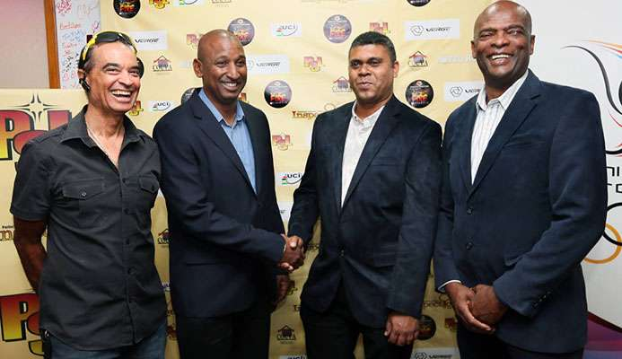 President of the TT Cycling Federation Robert Farrier, second from left, shakes hands with Mukesh Ramsingh of Metro Hotel, while PSL CEO Desmond Roberts, right, and cycling icon Gene Samuels, left, looks on at the PSL Fire on Wheels launch at TTOC headquarters, Abercromby Street, Port of Spain, yesterday. All smiles is from left while TTCF president Robert Farrier.