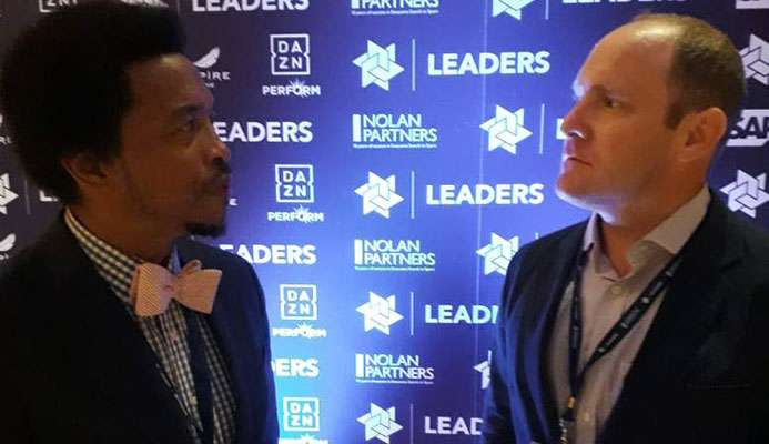 TTOC President Brian Lewis, left, chats with Whitney Kirkland, Partner, Firebrand Event Productions, at the 5th annual Leaders Sport Business Summit at The TimesCenter, New York, yesterday.