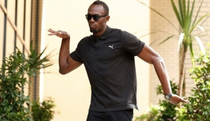 Usain Bolt arrives for his Anniversary Games press conference. Photograph: Andrew Couldridge/Reuters