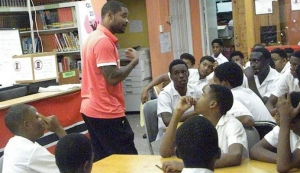 MOTIVATIONAL TALK: Double Olympic silver medallist Keston Bledman gives a motivational talk to third form pupils of the St James Secondary School, on Wednesday. —Photo: KWAME LAURENCE