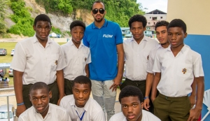 PHOTO: PROUD TO BE PRES: Machel Cedenio, holder of the national record for the men's 400M shares a moment with students from Presentation College, San Fernando at the school's career day.