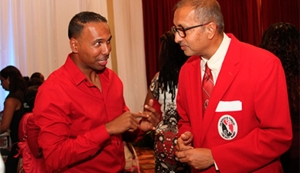 Right-arm leg-spin bowler Samuel Badree, left, chats with Baldath Mahabir, executive member of the TTCB at a reception for T&T and West Indies World T20 champions at the Hyatt Regency Trinidad recently. PHOTO: SEAN NERO