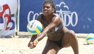 T&T's Malika Davidson plays a defensive shot to keep alive a play during her and playing partner Ayana Dyette's women's quarterfinal against Cayman Islands Jessica Wolfenden and Stefania Gandolfi women's quarterfinal the 2016 NORCECA Beach Volleyball Circuit Cayman Islands Beach Volleyball Tournament at Seven Miles Beach, Grand Cayman on Saturday afternoon. Wolfenden and Gandolfi won 21-13, 21-13. Photo: Courtesy NORCECA