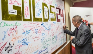 Presidential Signing: His Excellency signs the TTOC's #10Golds24 supporters' board at Olympic House in celebration of 100 days to the Rio Olympics. (Photo credit: CA-Images)