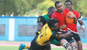 T&T foward Nigel Ballington is tackled by Jamaica's, left wing, Andrew Simpson during the teams' 2019 Rugby World Cup Rugby Qualifier at the Ato Boldon Stadium, Couva, yesterday. PHOTO: ANTHONY HARRIS
