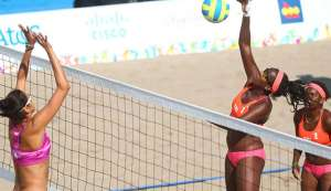 TT's Ayanna Dyette, second from right, competes at the 2015 Pan Am Games alongside partner Malika Davidson, right, against Mexico in Toronto, Canada.