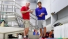 "Phelps with his coach, Bob Bowman, at a meet this month in Texas. ""I never thought that he would ever change,"" Bowman said, adding: ""He hid everything that makes him human for 12 years. The rehab is what opened him up."" TOM PENNINGTON / GETTY IMAGES"