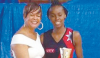 UTT's Candice Guerero collects the Most Valuable Player trophy from TTNA president Dr Patricia Butcher at the awards ceremony of the Courts All Sectors Netball League at the Eastern Regional Indoor Sports Arena in Tacarigua on Wednesday.