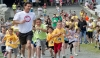 Parents and kids compete in a foot race during Olympic Day 2011.