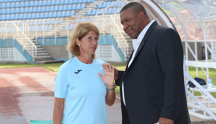 T&T Women's football team head coach Carolina Morace chats with TTFA president David John-Williams during here first training session at the Ato Boldon Stadium in Couva, last week. Photo by:TONY HOWELL