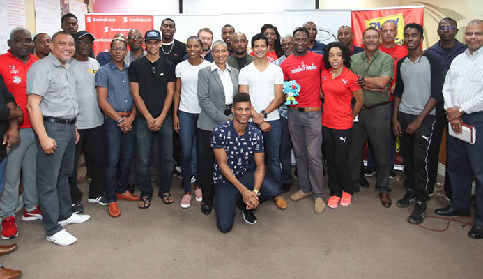 A group of national athletes and officials pose for a photo at the Olympic House, Port of Spain yesterday, during the ceremonial send-off for the TT Commonwealth Games contingent yesterday.
