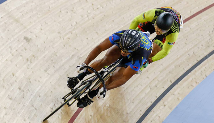 TT and Rigtech Sonics rider Njisane Phillip, left, defeats Edgar Verdugo of Mexico in three rides to progress to the semi-finals of the PSL Fire on Wheels held at the National Cycling Centre, Couva, Saturday.