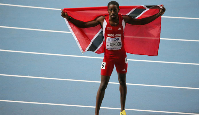 Trinidad and Tobago's Jehue Gordon celebrates winning the world 400m hurdles title in 2013 at the end of a season when he had had a physical imbalance identified and rectified by MJP staff ©Getty Images