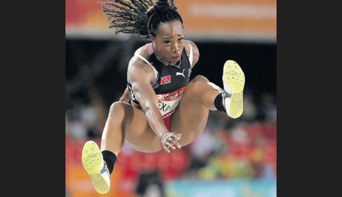 Ayanna Alexander of T&T competes in the women's triple jump final at Carrara Stadium during the Commonwealth Games on the Gold Coast, Australia, yesterday. AP PICTURE