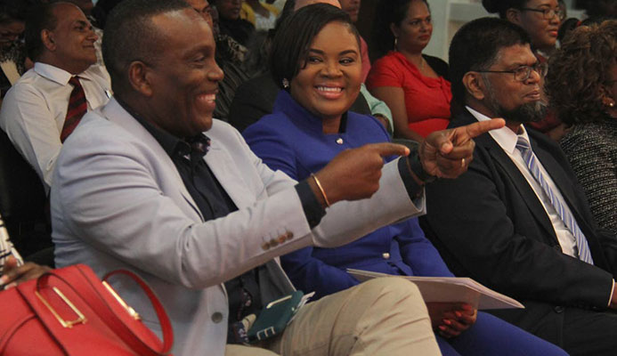 Minister of Sport and Youth Affairs Shamfa Cudjoe,centre, shares a laugh with Member of Parliament for Tunapuna Esmond Forde,left, at the Rewards, Recognition and Cheque Presentation Ceremony, at the National Racquet Centre, Tacarigua yesterday.