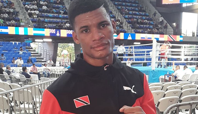 Boxer Michael Alexander earned T&T's first medal at the Pan Am Games, a bronze, on Tuesday night.