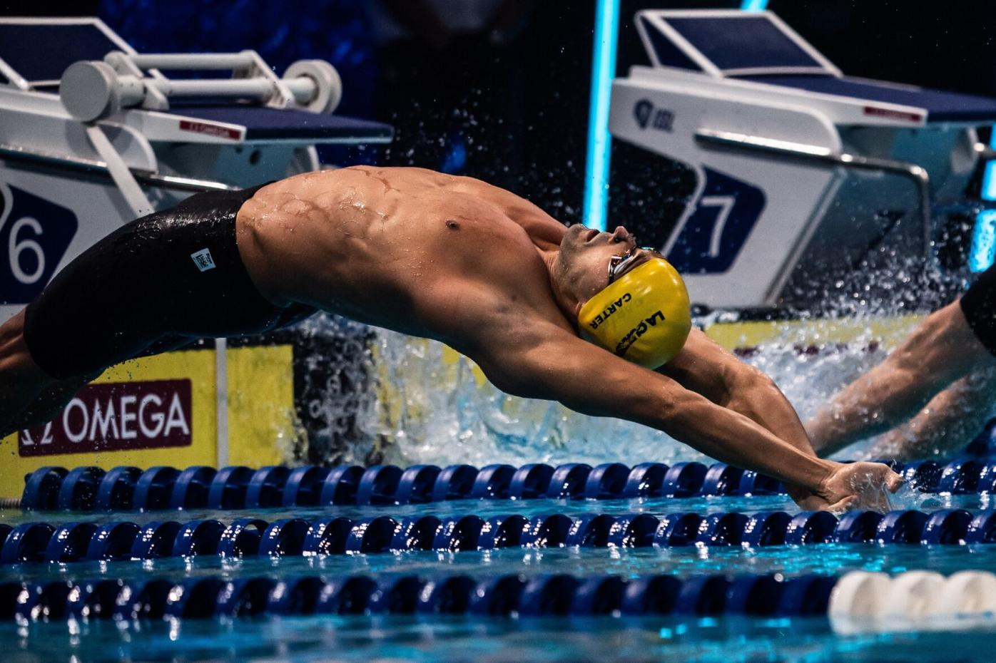 (flashback) FULL STRETCH: Los Angeles Current's Dylan Carter gets off to a quick start in the Men's 100m backstroke, during match number 10 of the International Swimming League (ISL) 2020, at the Duna Arena in Budapest, Hungary, yesterday. Carter bagged silver in the event, in a new national record time of 50.11 seconds. --Photo courtesy ISL