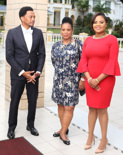 Photo: TTOC president Brian Lewis (left) and secretary general Annette Knott (centre) chat with Minister of Sport and Community Development Shamfa Cudjoe. (via TTOC)
